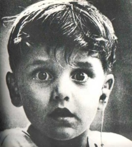 Harold Whittles hearing for the first time after a doctor place an earpiece in his left ear.
